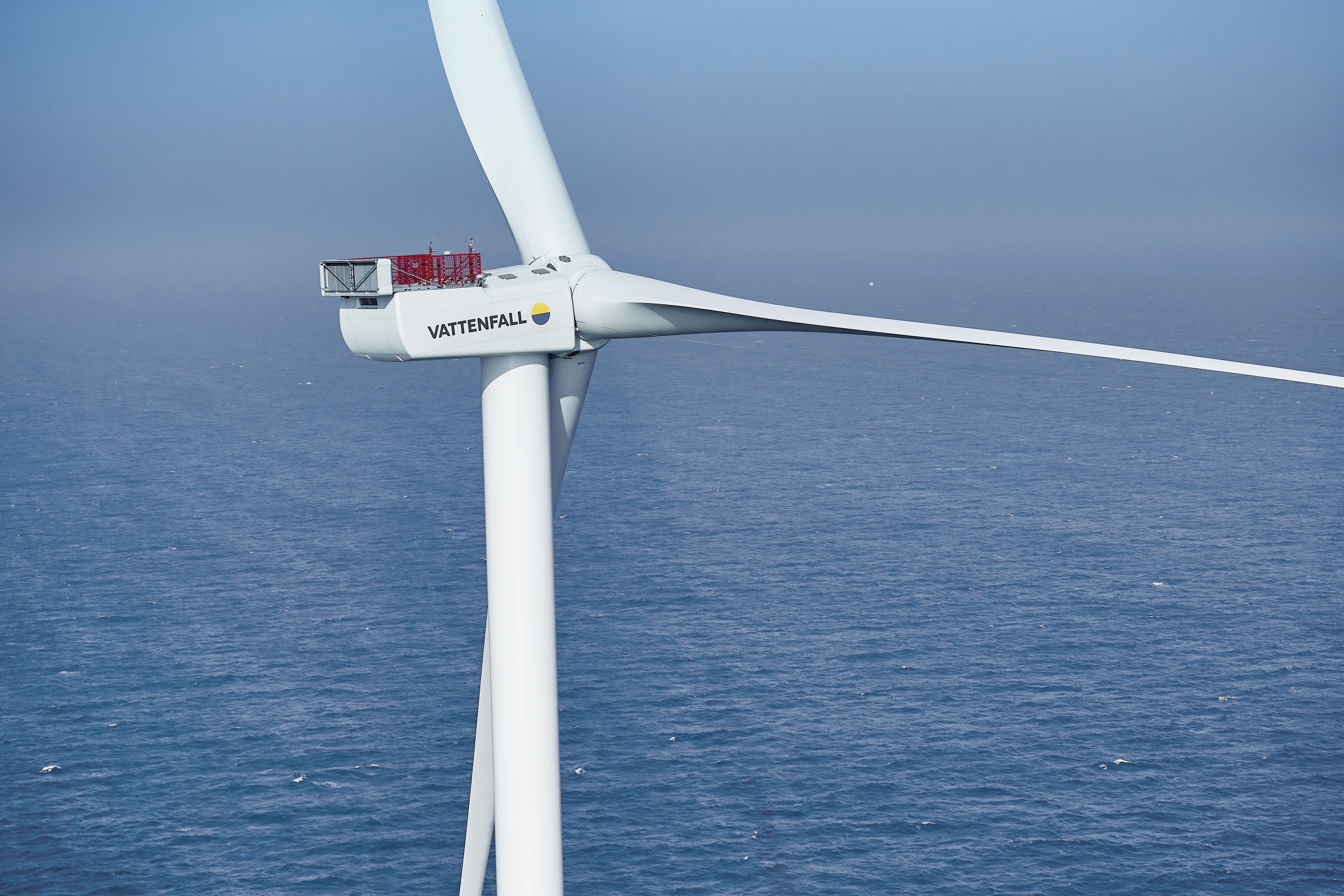 Image of a wind turbine located in the sea.