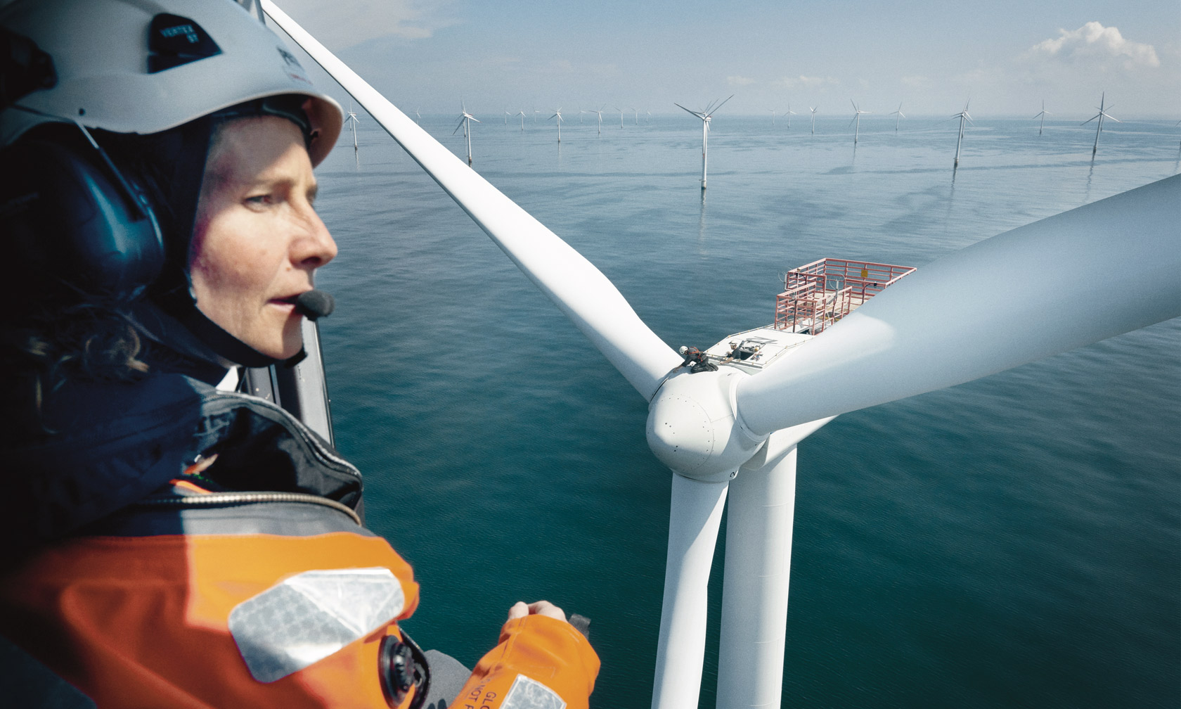 Woman in helicopter looking down on turbines at Horns Rev offshore wind farm
