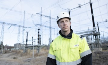 A man in a helmet with power lines in the background