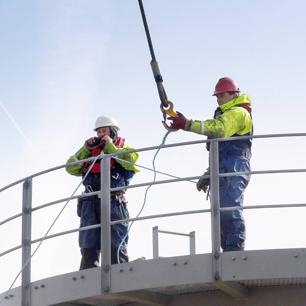 Two workers on a turbine at Kentish Flats wind farm