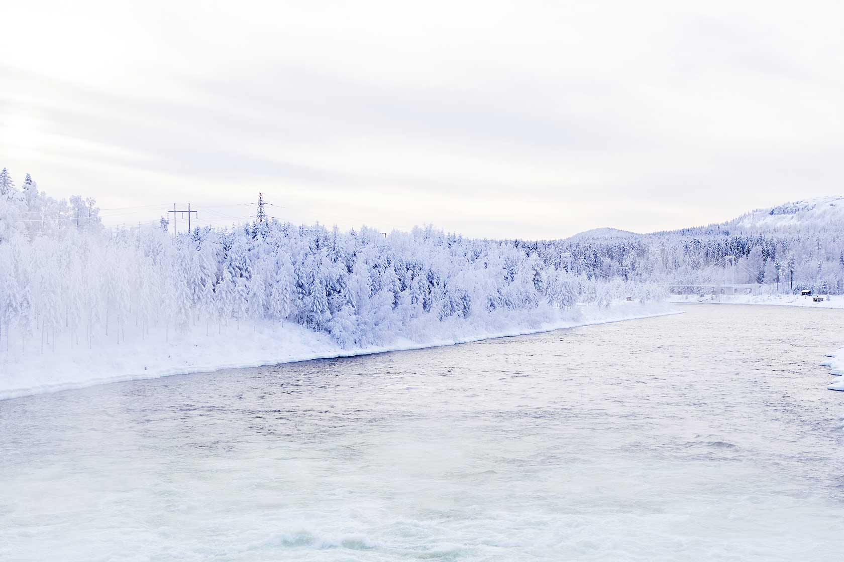 Winter landscape in nothern Sweden with power line.