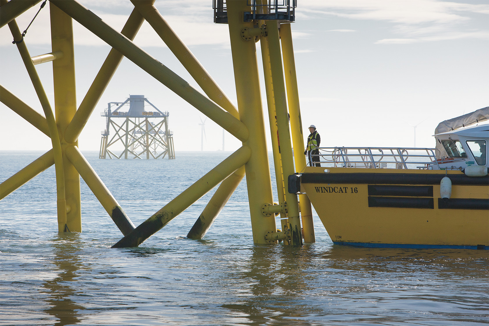 Man on a ship inspecting foundations at Ormonde offshore wind farm