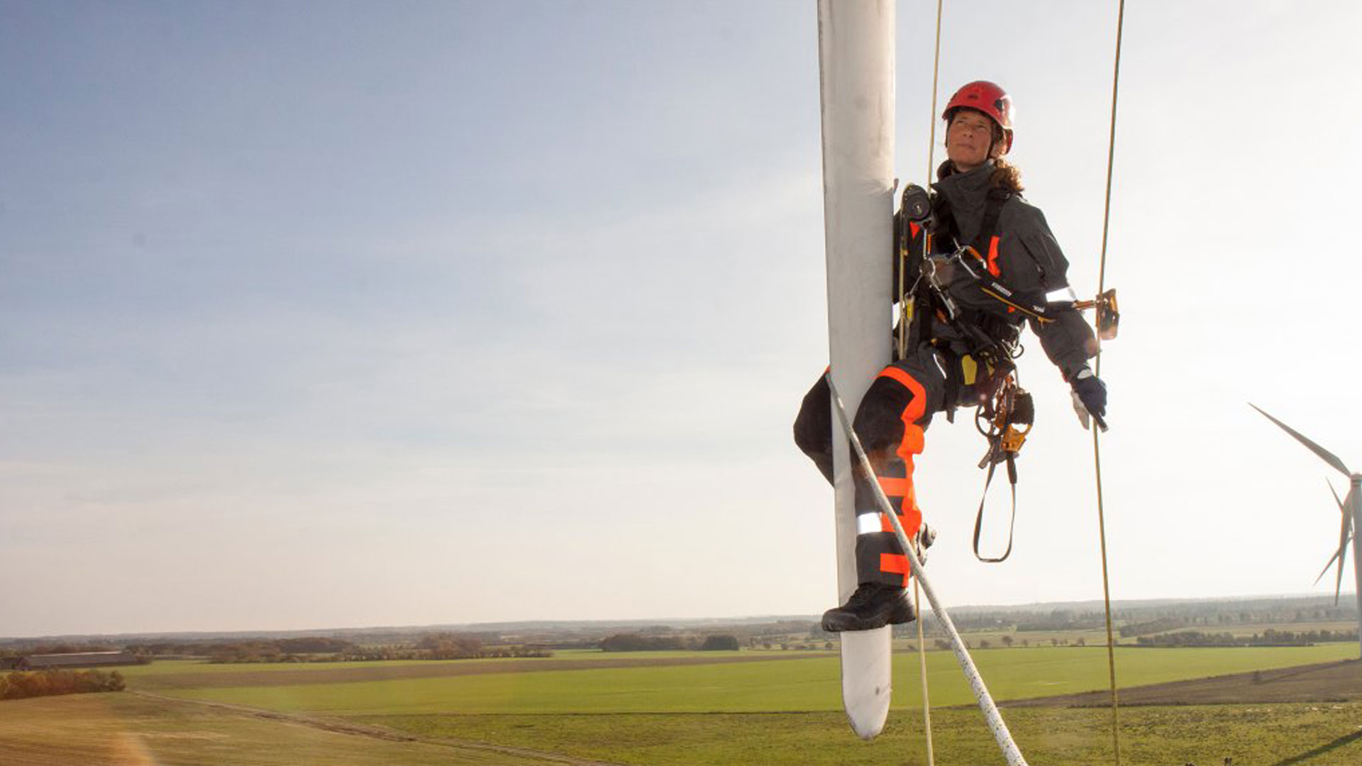 Rikke Juul Balle hanging from a turbine
