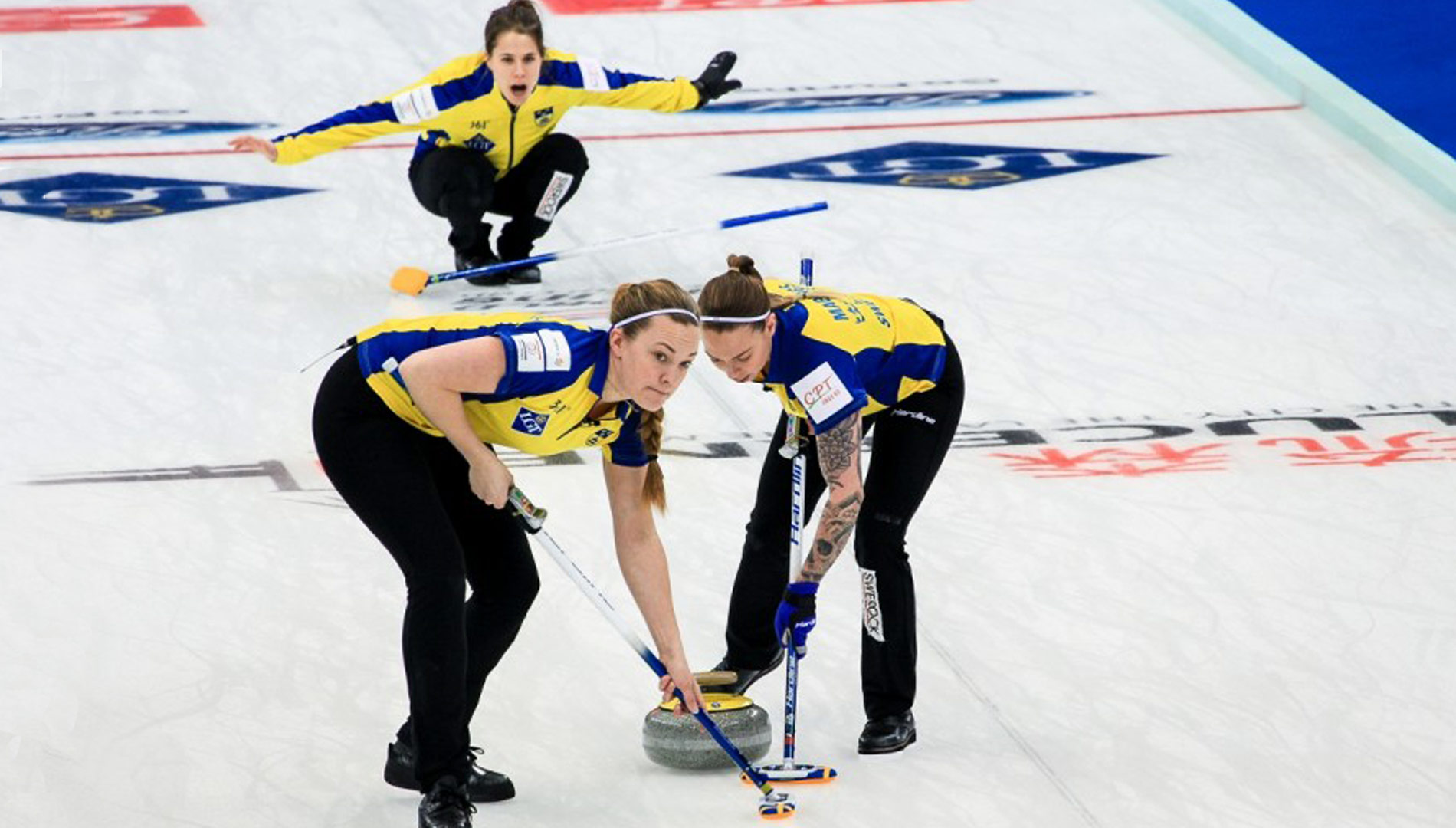 Agnes playing curling with her team. Photo: World Curling Federation