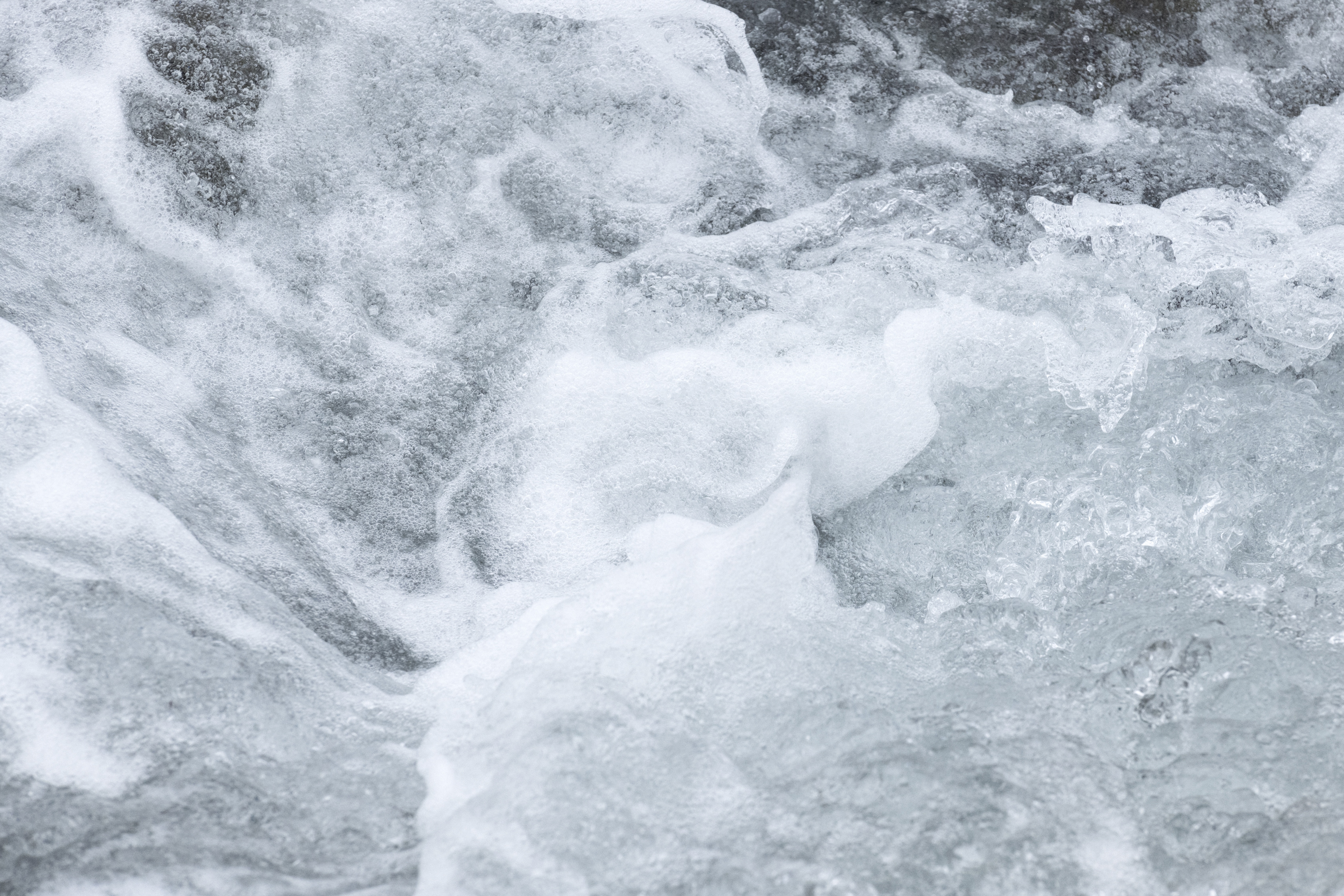 Image of swirly and foaming water in a stream.